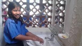Washing hands at school toilet blocks