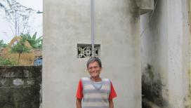 Man in front of toilet